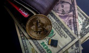 bitcoin moneta leżąca dolary portfel pieniądze nowy sposób zarabiania